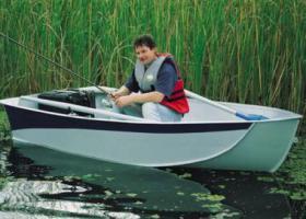 рыбак в лодке Язь